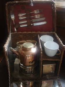 Picnic basket with small kettle. My Mum told me that her uncle had one that was a bit like this (but not as posh) and the kettle was powered by meths.